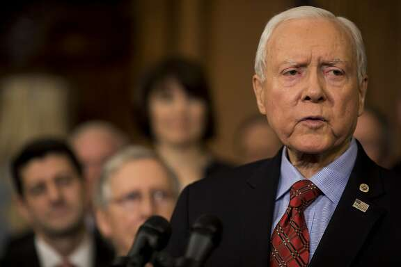 Senator Orrin Hatch, a Republican from Utah, speaks during a Tax Cuts and Jobs Act enrollment ceremony at the U.S. Capitol in Washington, D.C., U.S., on Thursday, Dec. 21, 2017. Republicans want to channel momentum from the GOP's victory on taxes into a push to overhaul the nation's welfare programs, though some of PresidentDonald Trump's advisers prefer a less controversial infrastructure plan at the top of his agenda. Photographer: Aaron P. Bernstein/Bloomberg