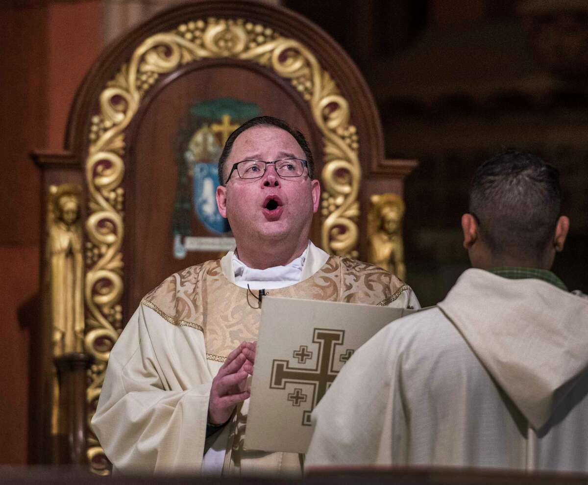 Father David R. LeFort, left officiates over the Christmas Day service at the Cathedral of Immaculate Conception Monday Dec 25, 2017 in Albany, N.Y. (Skip Dickstein/ Times Union)