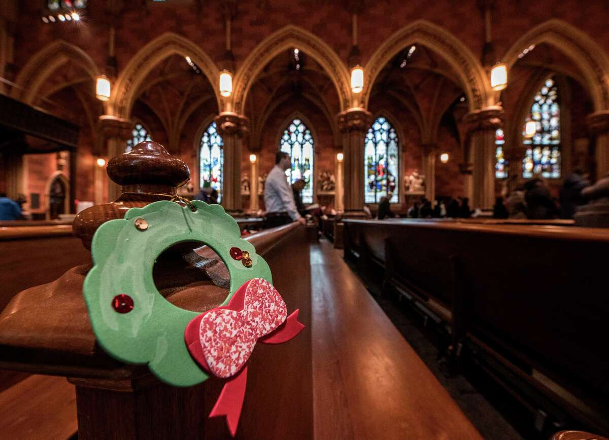 Parishioners enjoy the carols and hymns as they participate in the Christmas Day service at the Cathedral of Immaculate Conception Monday Dec 25, 2017 in Albany, N.Y. (Skip Dickstein/ Times Union)
