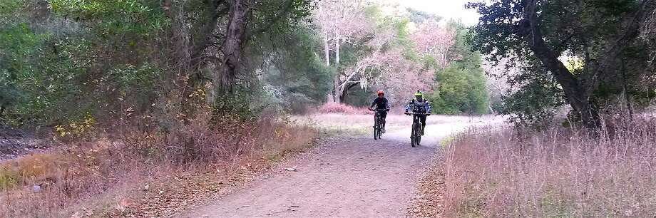 Mountain bikers ride up Hunting Hollow Road, the gateway to 87,000 acres of parkland at Henry W. Coe State Park Photo: Tom Stienstra, Tom Stienstra / The Chronicle