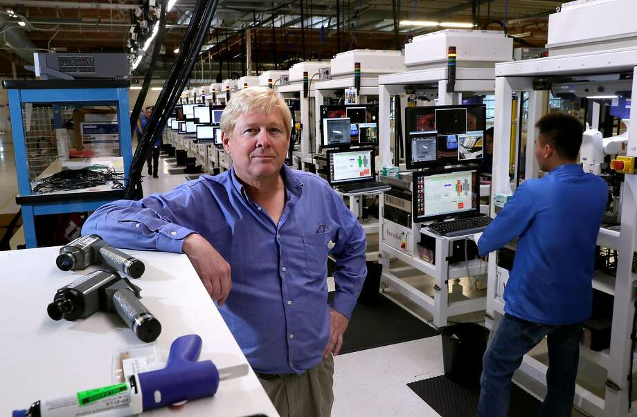 """David Hall, founder and CEO of Velodyne, on the factory floor in San Jose. Velodyne makes laser sensors known as lidar that help robot cars """"see"""" the world around them. Photo: Michael Macor, The Chronicle"""