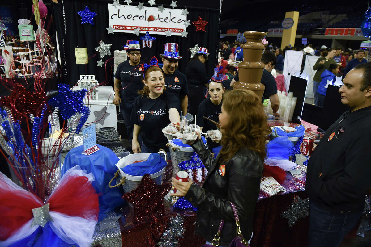 Cibeles Tena smiles on Thursday night as she hand samples from Chocoloteka to food enthusiasts in attendance at the Laredo Energy Arena for the Taste of Laredo.