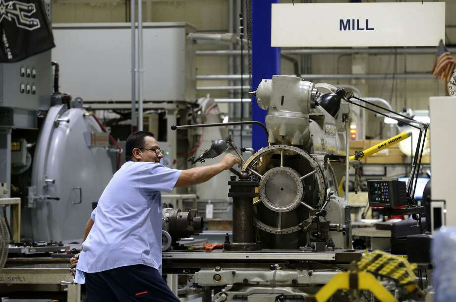 A StandardAero employee works a mill at the company's San Antonio facility. StandardAero secured a $380 million Air Force contract on Dec. 21 to continue maintenance of the T56 engine. Photo: John Davenport /San Antonio Express-News / ©John Davenport/San Antonio Express-News
