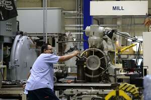 A StandardAero employee works a mill at the company's San Antonio facility. StandardAero secured a $380 million Air Force contract on Dec. 21 to continue maintenance of the T56 engine.
