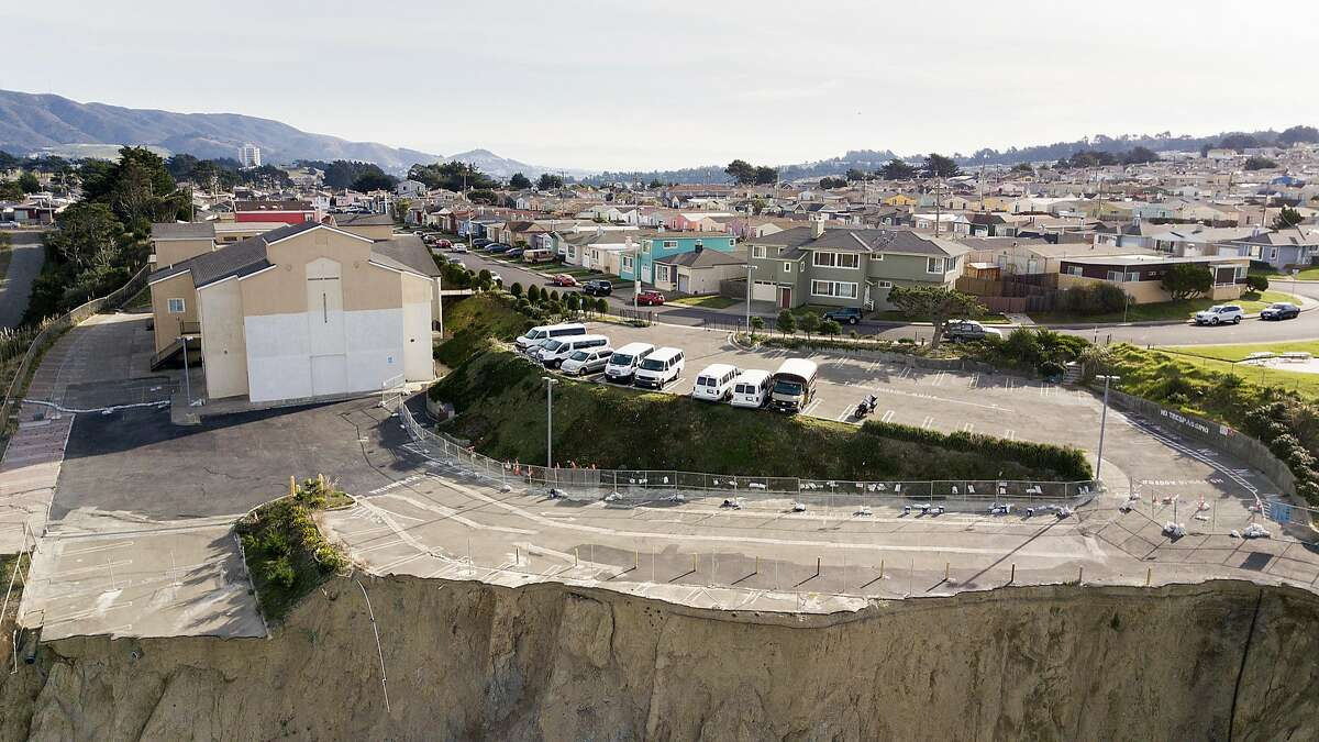 An eroded cliffside lies beneath a parking lot at Christ Central Presbyterian Church in Daly City, Calif., on Friday, Dec. 22, 2017.