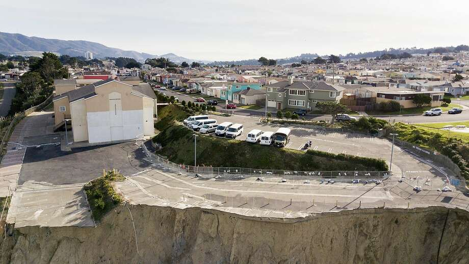 At Christ Central Presbyterian Church in Daly City, the parking lot has been undercut by erosion of the cliffside on the Pacific shoreline. Photo: Noah Berger, Special To The Chronicle