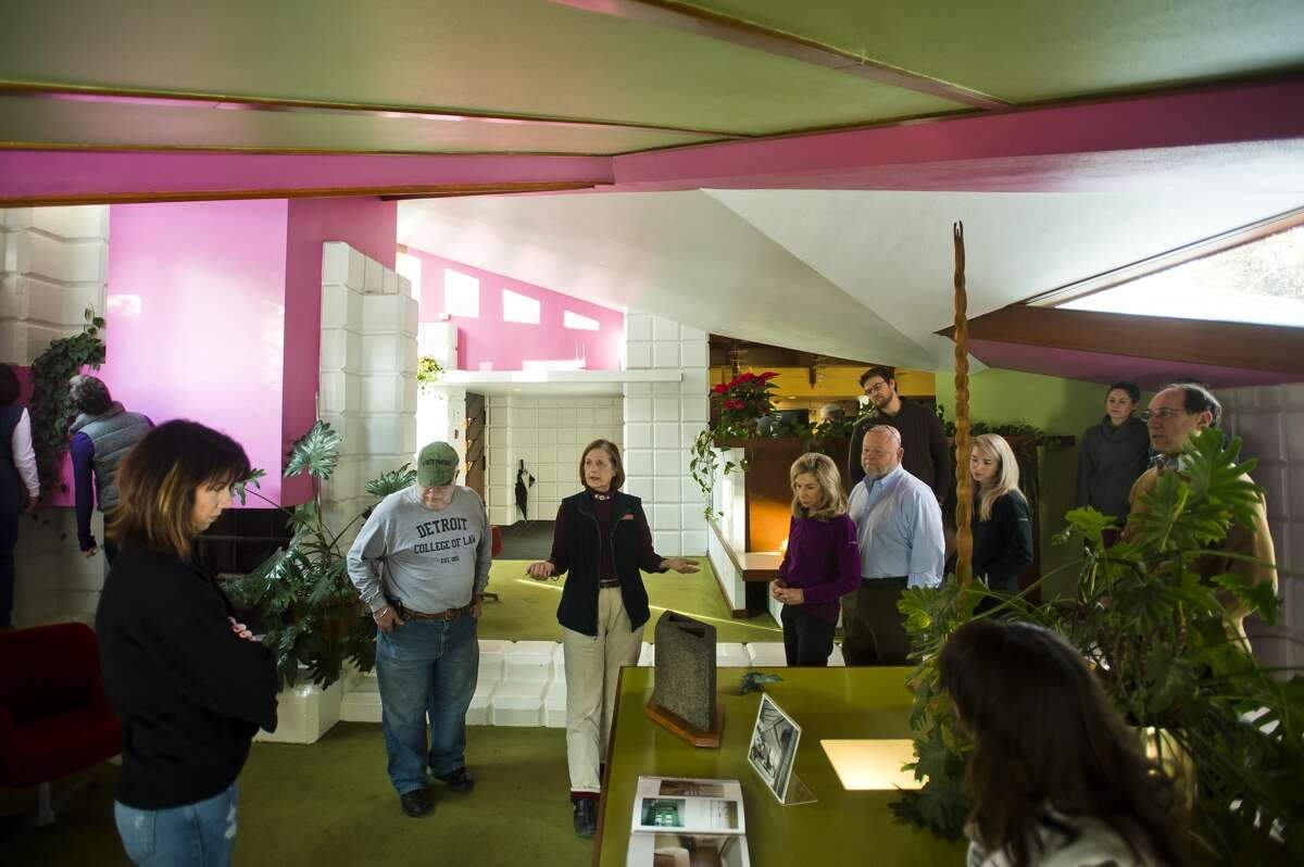 Midland resident Daria Potts, center, gives a guided tour of the Alden B. Dow Home and Studio on Tuesday, Dec. 26, 2017. Tours are available Monday through Saturday at 2 p.m. and on Friday and Saturday at 10 a.m. They cost $15 for adults, $12 for seniors and $7 for students. For the month of January, tours will not be available, but will pick up again in February. (Katy Kildee/kkildee@mdn.net)