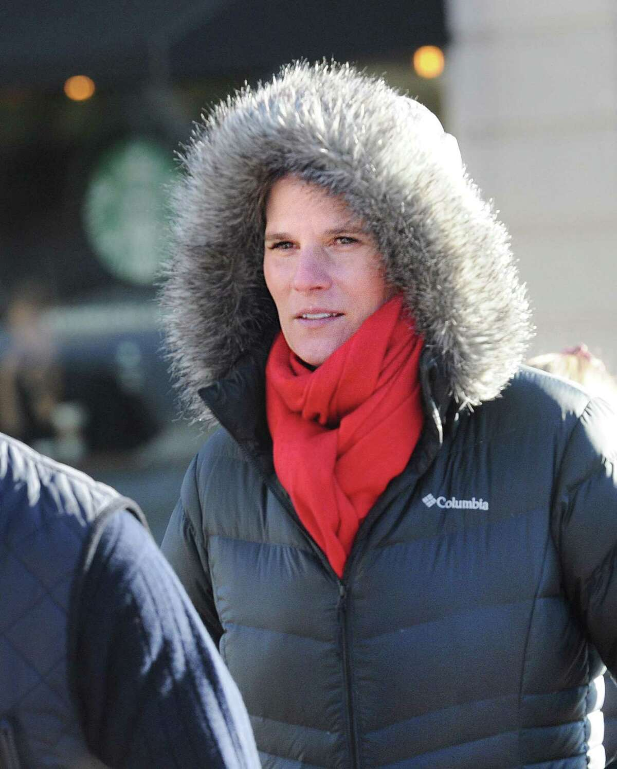 With the temperature in the mid-20 degree range, Southern Californian Alix Hobbs, was decked out in a winter coat with a hood and wore a scarf as she walked on Greenwich Avenue in Greenwich, Conn., Tuesday, Dec. 26, 2017. When asked about the cold weather Hobbs said,