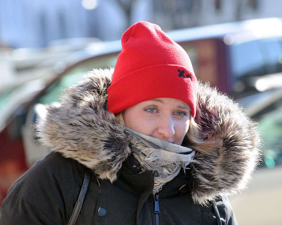 With temperatures in the mid-20 degree range, a woman in full winter gear walks on Greenwich Avenue in Greenwich, Conn., Tuesday, Dec. 26, 2017. The National Weather Service is forecasting even colder temperatures throughout the week with single digits expected during the overnight on Wednesday, Thursday and Friday with a chance of snow on Friday and Saturday.