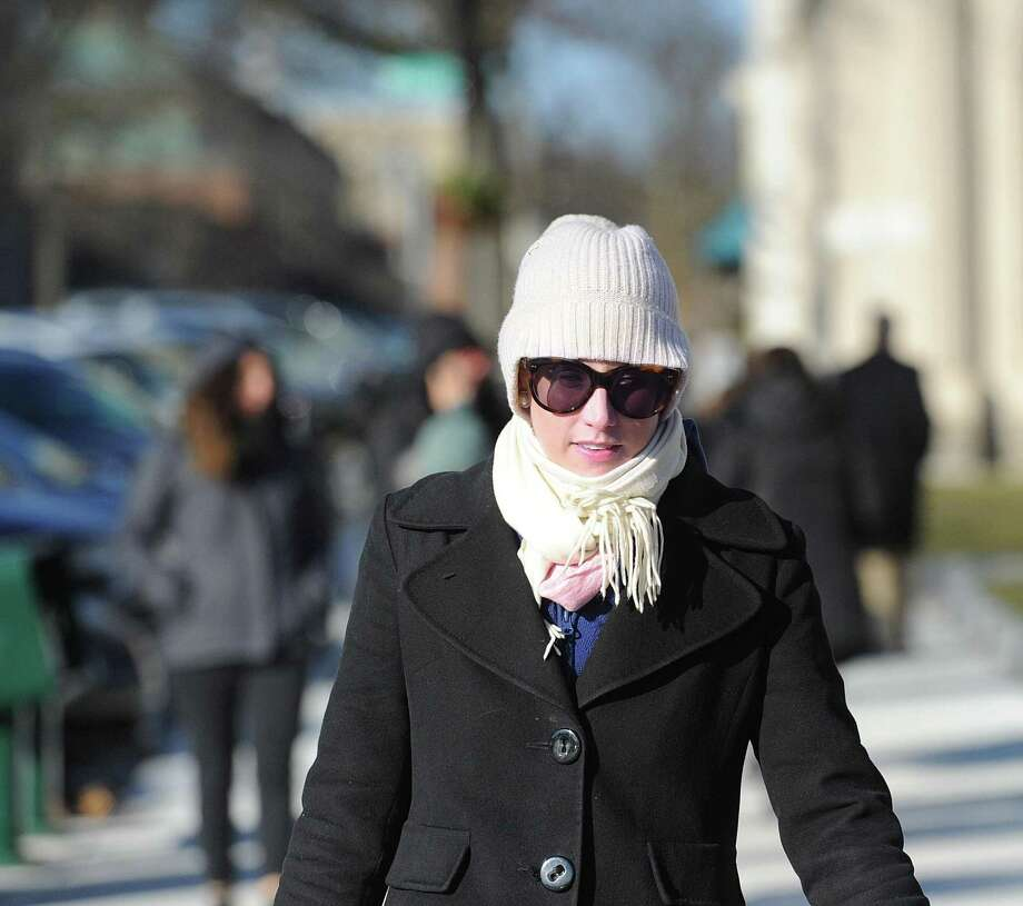 Photos of people walking in the cold weather on Greenwich Avenue in Greenwich, Conn., Tuesday, Dec. 26, 2017. The National Weather Service is forecasting even colder temperatures throughout the week with single digits expected during the overnight on Wednesday, Thursday and Friday with a chance of snow on Friday and Saturday. Photo: Bob Luckey Jr. / Hearst Connecticut Media / Greenwich Time