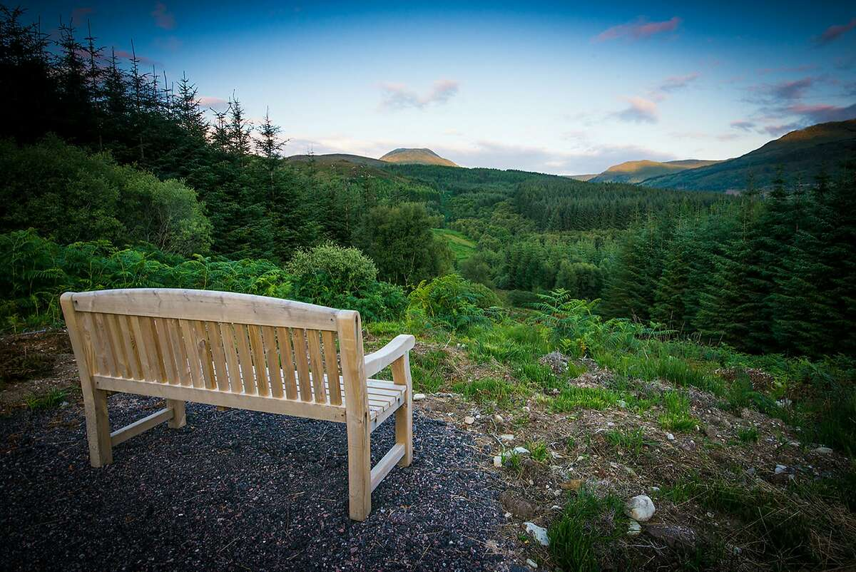 A bench that overlooks the Highland Titles Nature Reserve at Glencoe Wood. Anyone can buy a tiny portion of the park -- which preserves it from ever being developed -- and supposedly gets to call themselves a laird, lord or lady of Glencoe, Scotland.
