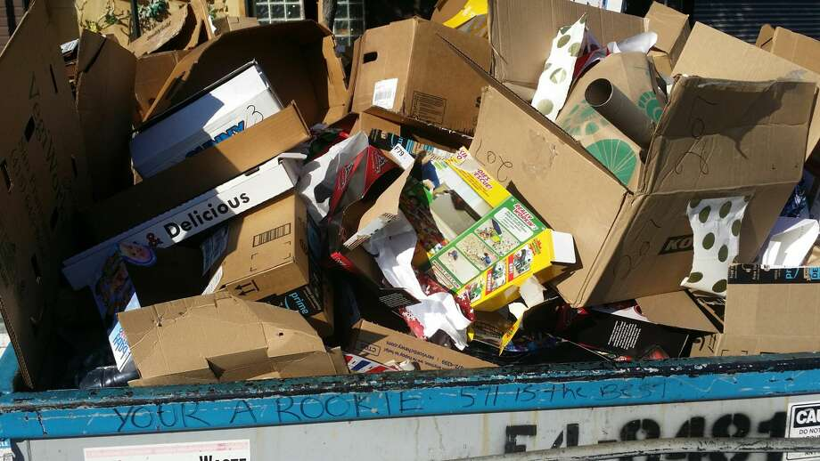 Cardboard boxes flood San Francisco's recycling plant. Recology, the city's waste and recycling hauler, asks that people break down their boxes. See properly broken-down boxes in the following slides. Photo: Recology