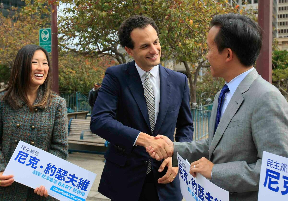 Nick Josefowitz, candidate for BART Board in the upcoming November election, shakes hands with District 3 Supervisor David Chiu while Supervisor Katy Tang (left) looks on during a press conference at Portsmouth Square in San Francisco's Chinatown highlighting the support he has received from the Chinese community as well as all three of the Chinese members of San Francisco's Board of Supervisors Friday, October 17, 2014.