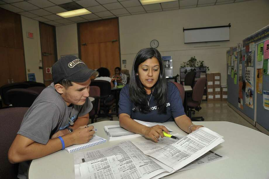 Sam Rayburn High School graduate Gerardo Garza receives guidance from Christine Coronado, a San Jacinto College shared counselor at Sam Rayburn and Pasadena High Schools. Another source of help for young students is Catch the Next Inc., a college-readiness program focusing on underserved communities. Photo: /For The Citizen / For The Citizen