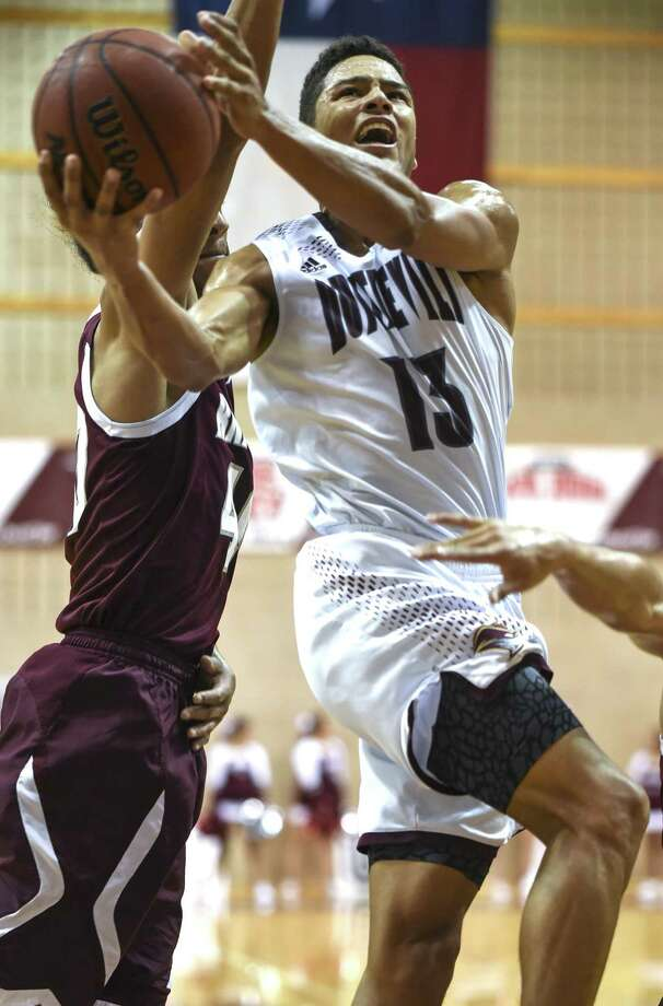 TAMIU senior guard Xabier Gomez had a team-best 15 points as he frequently reached the free-throw line, but the Dustdevils lost their season opener 61-54 Friday night. Photo: Danny Zaragoza /Laredo Morning Times File