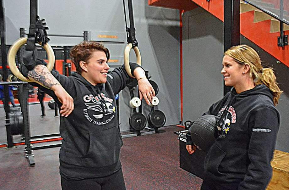 Taylor Arrigoni, left, general manager of the new gym, GoToFitness Ultimate Training Center at 1385 Newfield St., Middletown, is daughter of owner Robert Hurd. Here, she talks with Liz Scovill, assistant manager of GoToFitness and Snap Fitness in Portland. Photo: Cassandra Day / Hearst Connecticut Media