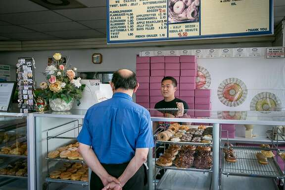 Danit Lean, son of the owner of A's Donuts helps customers in Santa Rosa, Calif., on November 19th, 2017.