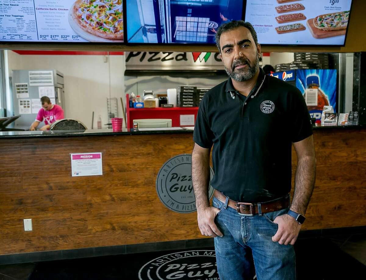 Hooman, owner of the Pizza Guys in Santa Rosa, Calif., is seen on November 19th, 2017.