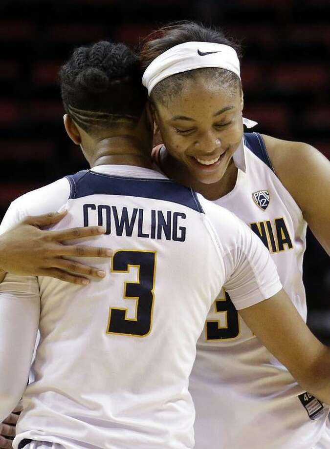 Mikayla Cowling, here embracing Kristine Anigwe, is among Cal's best players on both sides of the court. Photo: Elaine Thompson / AP / Copyright 2017 The Associated Press. All rights reserved.