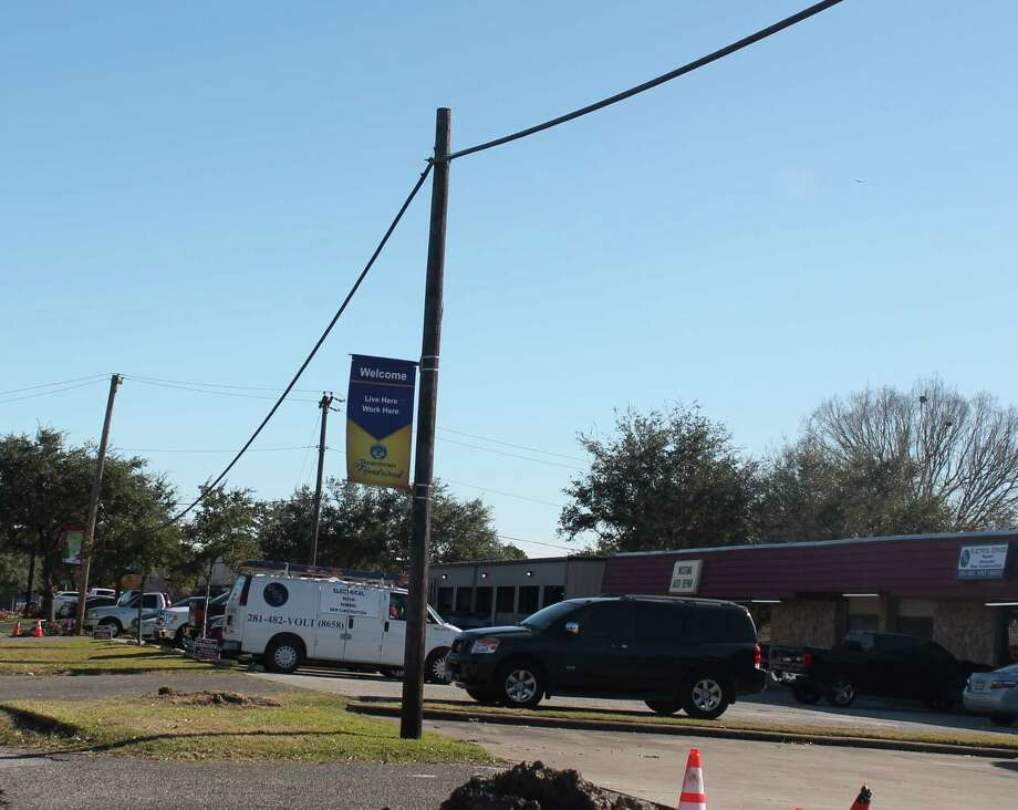 AT&T poles and wires on a section of the west side of Friendswood Drive are being replaced with underground cable.