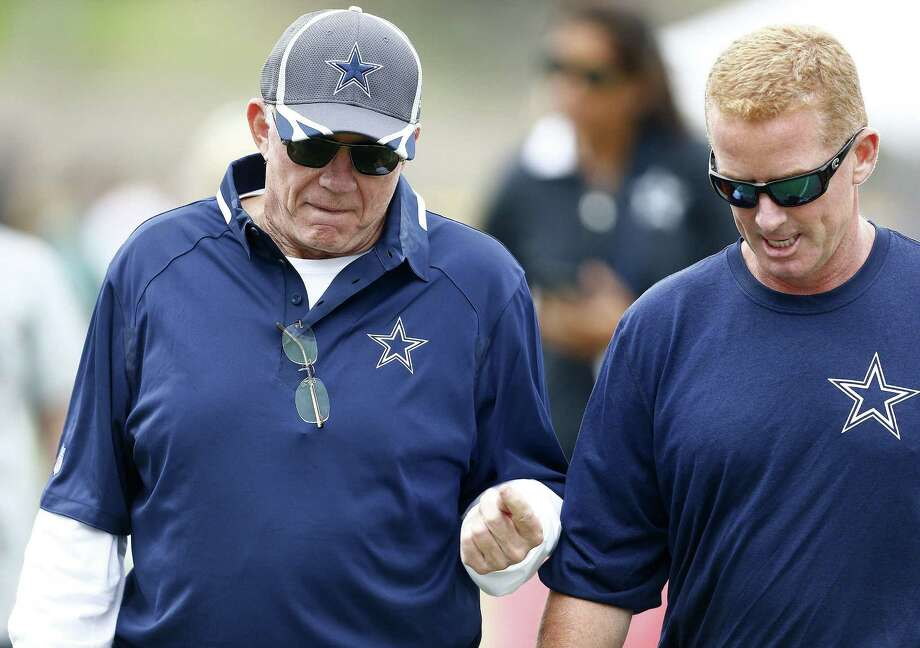 Dallas Cowboys owner and general manager Jerry Jones, left, talks with head coach Jason Garrett following the evening workout during training camp Saturday Aug. 9, 2014, in Oxnard, Calif. Photo: Ron Jenkins /TNS / Fort Worth Star-Telegram