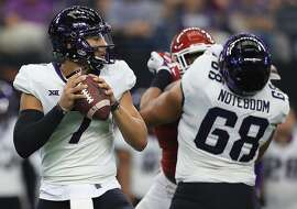 ARLINGTON, TX - DECEMBER 02:  Kenny Hill #7 of the TCU Horned Frogs looks to pass against the Oklahoma Sooners in the second quarter during Big 12 Championship at AT&T Stadium on December 2, 2017 in Arlington, Texas.  (Photo by Ronald Martinez/Getty Images)