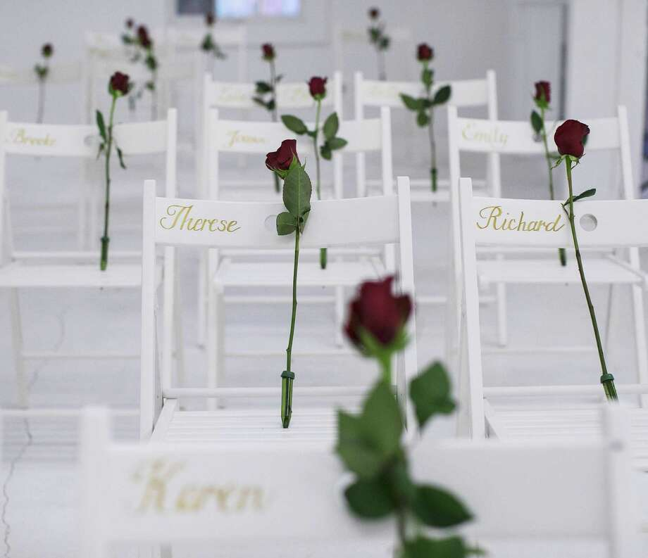 Roses on chairs with the names of those killed during a mass shooting at First Baptist Church in Sutherland Springs, Texas, which has been transformed into a memorial to honor those who died, Dec. 7, 2017. After decades of serious lapses in reporting crimes to the FBI and to the national gun background-check database, officials from New York, Philadelphia and San Francisco are suing the Pentagon, hoping to require it to submit to federal court monitoring of its compliance with the reporting laws it has broken time and again. Photo: RUTH FREMSON /NYT / NYTNS