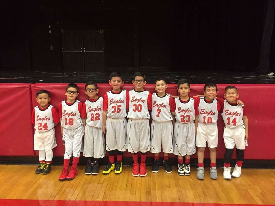 The Blessed Sacrament first grade Eagles basketball team played in the 8A championship game on Sunday at the Boys & Girls Club. From left are Sean, Roman, Robert, Jake, Dallas, Markus, JJ, Juan and Carlos. Photo: Courtesy Photo