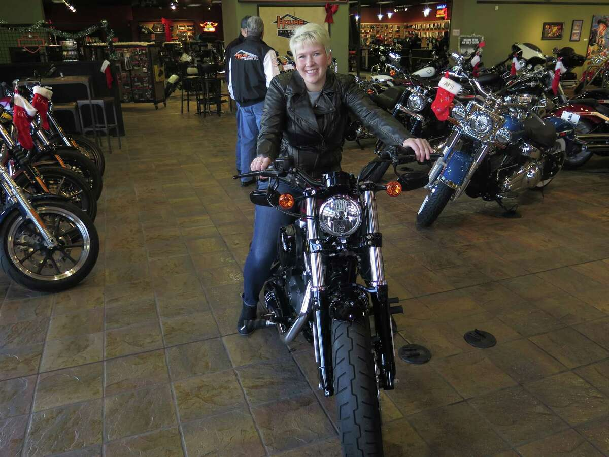 In this Dec. 12, 2017, photo, Samantha Kay poses for a photo on a 2017 Harley Sportster Forty-Eight in Milwaukee's House of Harley. Kay took a riding course at the dealership as part of Harley-Davidson's