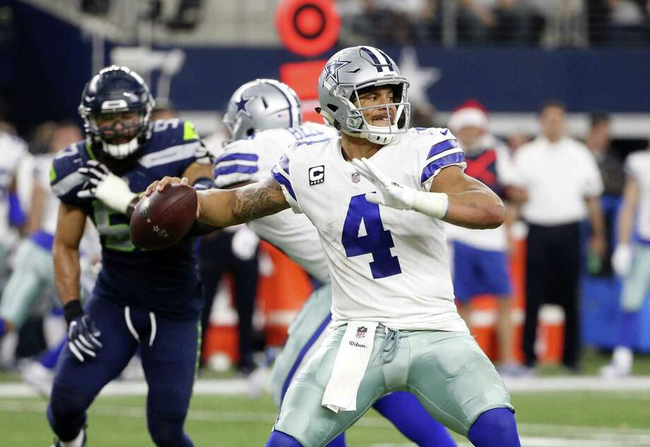 Dak Prescott and the Cowboys settled for six field goals Sunday and missed two in a 21-12 loss at home to Seattle to eliminate Dallas from playoff contention. Photo: Michael Ainsworth /Associated Press / FR171389 AP