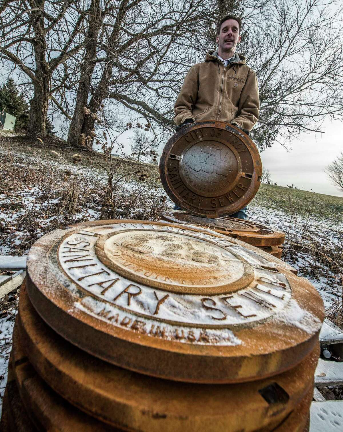 Public Utilities superintendent Chris Wheland stands near manhole covers and frames ready for installation sit in the yard at the Troy Water Plant Friday Dec 15, 2017 in Troy, N.Y. (Skip Dickstein/ Times Union)