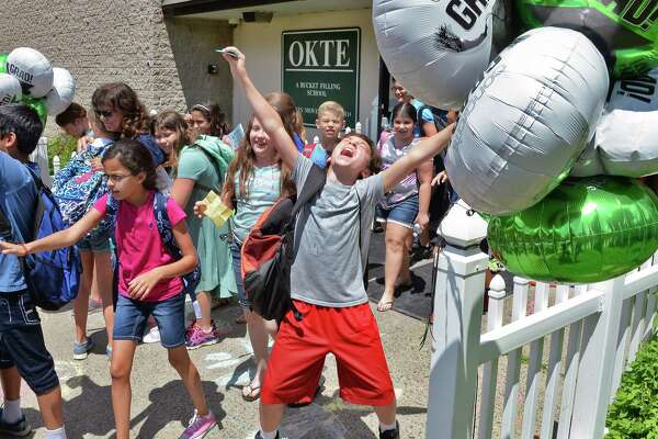 Ecstatic fifth grader Asher Urowsky, center, leaves Okte Elementary School on the last day of school Thursday June 22, 2017 in Clifton Park, NY.