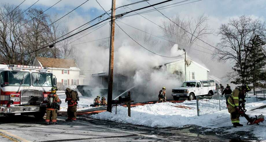 A mutual aid fire guts a residence at 490 Church Road on Tuesday, Dec 26, 2017, in Guilderland, N.Y.  (Skip Dickstein/ Times Union) Photo: SKIP DICKSTEIN