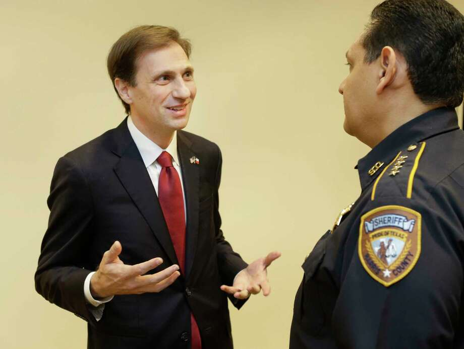 Justin Nelson, a Democratic candidate for Texas Attorney General, left, talks with Harris County Sheriff Ed Gonzalez on Dec. 19, 2017, in Houston. Photo: Melissa Phillip, Houston Chronicle / © 2017 Houston Chronicle