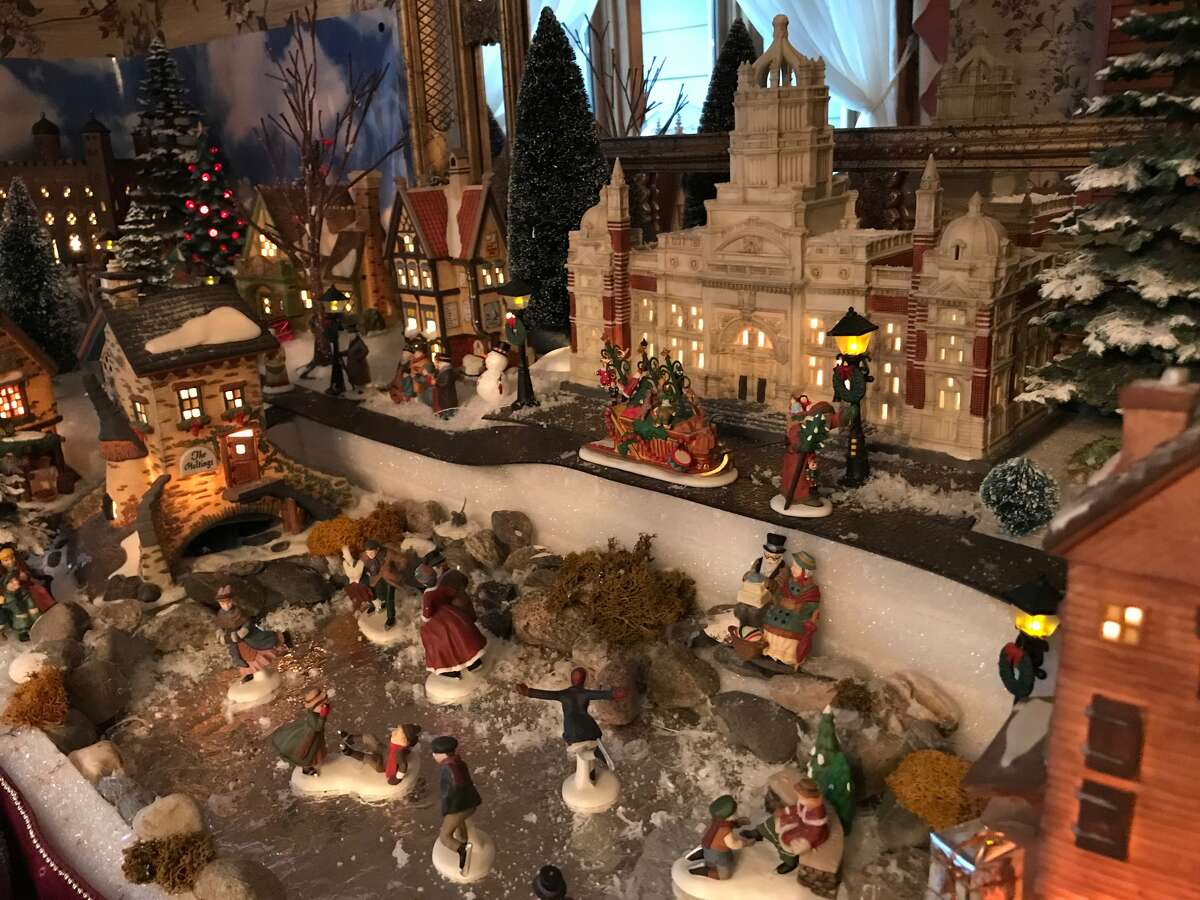 Kenneth Mortensen Sr.'s Christmas villages have overtaken the living room, dining room, TV room, computer room and kitchen of his Selkirk home.