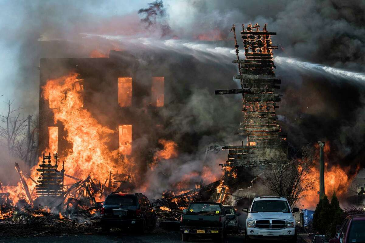 Firefighters from around the region work their best to knock down a multi-alarm fire consumes a number of building on Remsen Street Thursday Nov. 30, 2017 in Cohoes, NY.