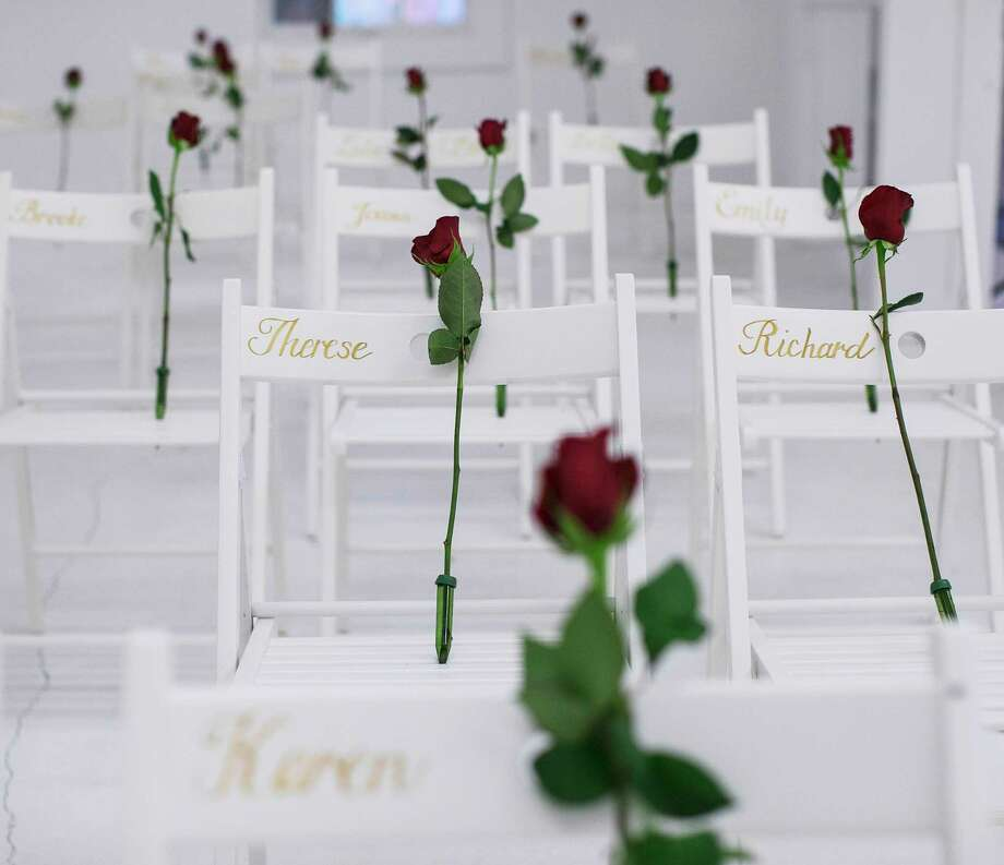 Roses on chairs honor those killed during the mass murders at a church in Sutherland Springs, Texas - carried out by a man who was able to buy a gun despite his conviction in the military.  Photo: RUTH FREMSON, STF / NYTNS