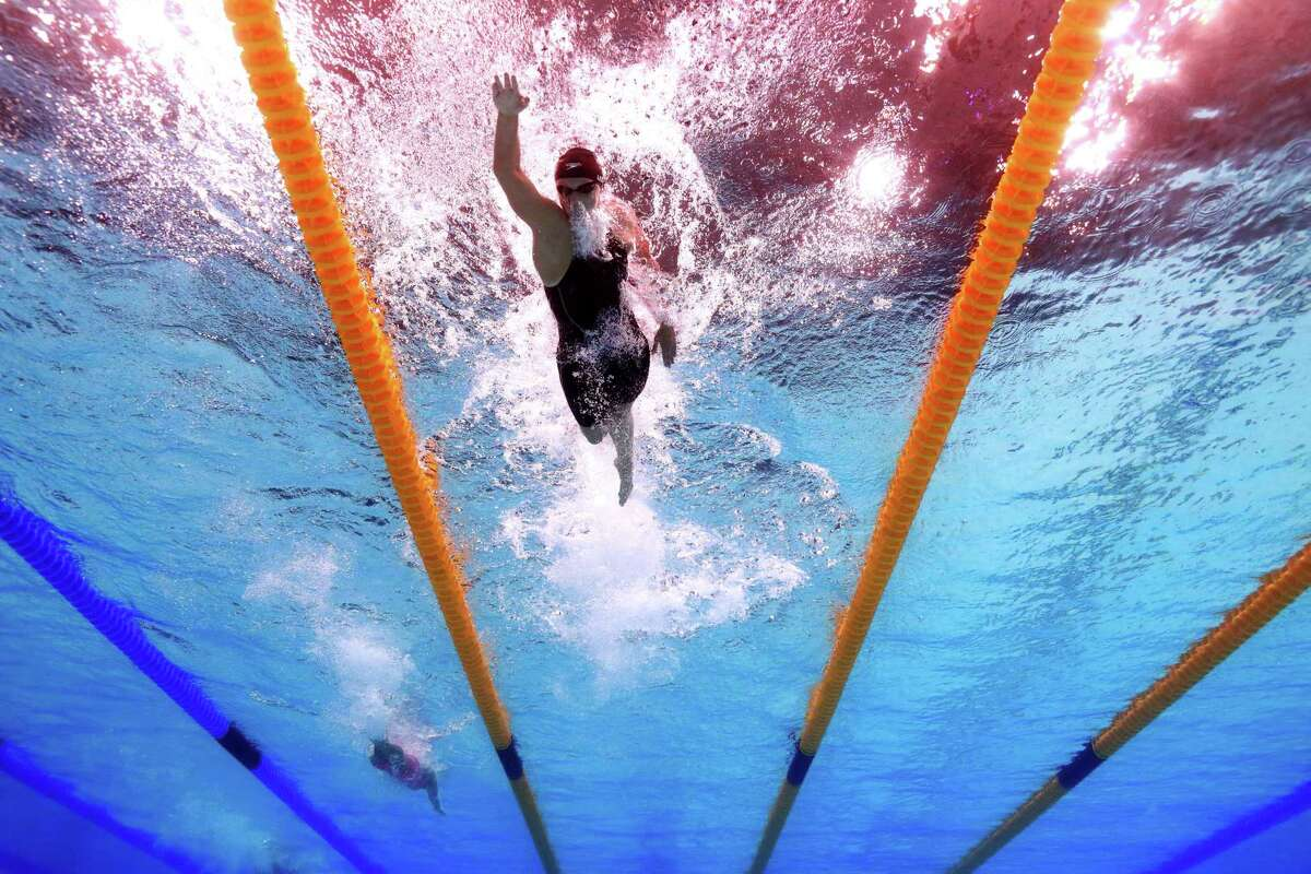 BUDAPEST, HUNGARY - JULY 25: Katie Ledecky (C) of the United States laps her fellow competitors during the Women's 1500m Freestyle final on day twelve of the Budapest 2017 FINA World Championships on July 25, 2017 in Budapest, Hungary. (Photo by Adam Pretty/Getty Images) ORG XMIT: 700047477
