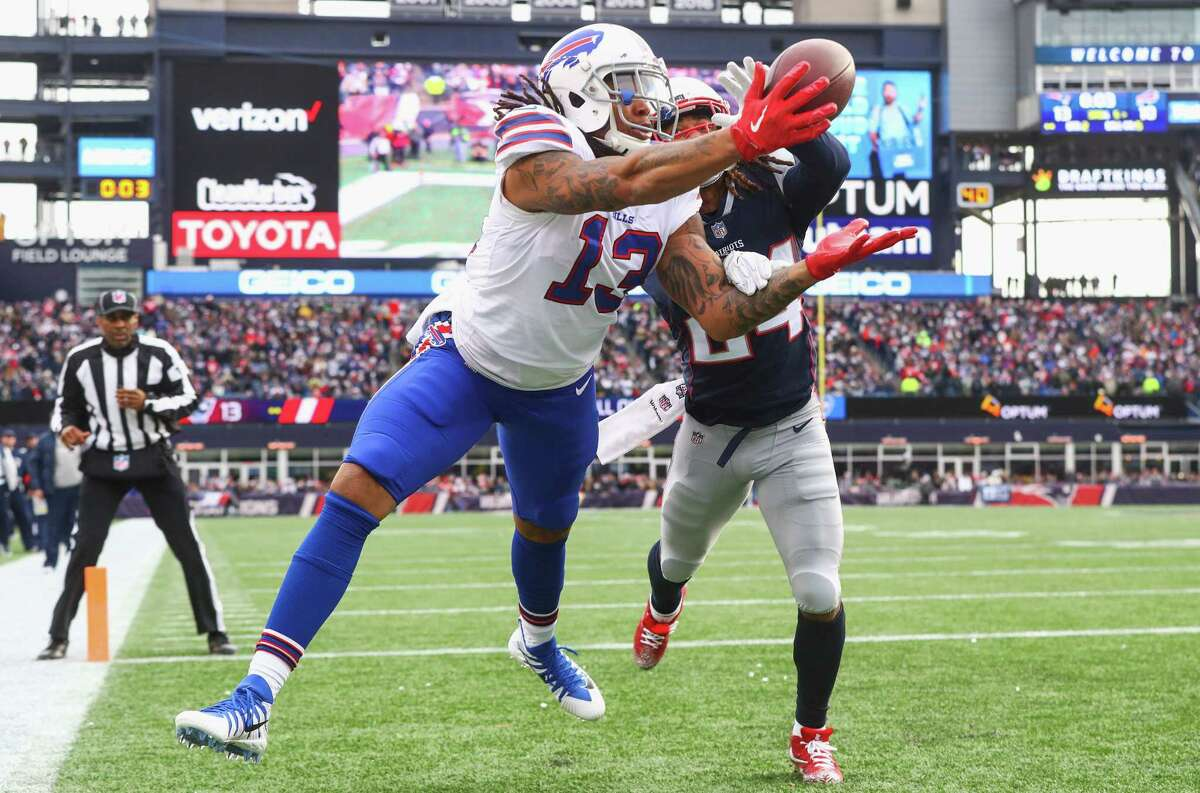 FOXBORO, MA - DECEMBER 24: Kelvin Benjamin #13 of the Buffalo Bills catches a touchdown pass as he is defended by Stephon Gilmore #24 of the New England Patriots during the quarter of a game against the Buffalo Bills at Gillette Stadium on December 24, 2017 in Foxboro, Massachusetts. The touchdown was reversed after an official review. (Photo by Maddie Meyer/Getty Images)