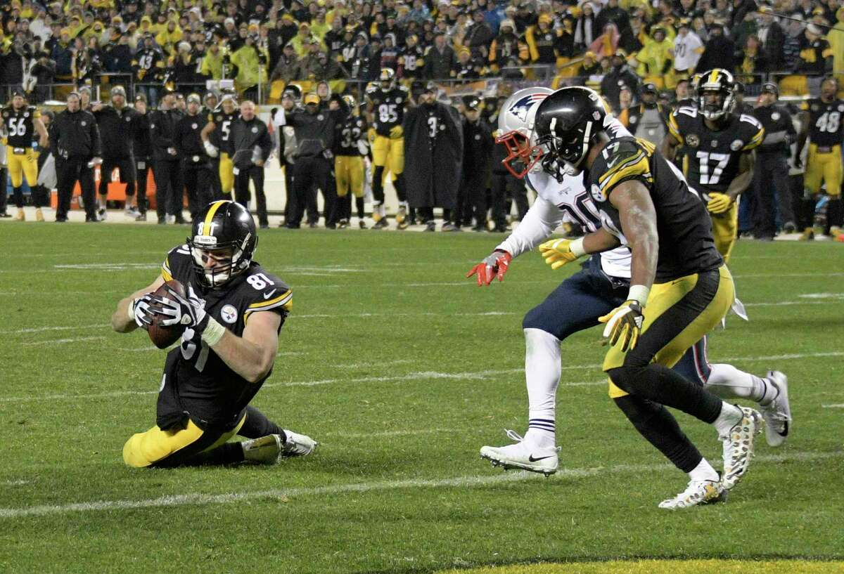 Pittsburgh Steelers tight end Jesse James (81) has a knee down before crossing the goal line with a pass from quarterback Ben Roethlisberger during the second half of an NFL football game against the New England Patriots in Pittsburgh, Sunday, Dec. 17, 2017. (AP Photo/Don Wright) ORG XMIT: PAGP151