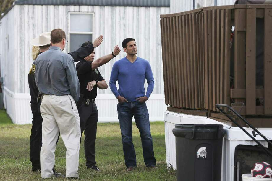 Bexar County District Attorney Nico LaHood listens as law enforcement officials investigate the shooting deaths of an unarmed woman and a child in a mobile home park in Schertz last week. Photo: Express-News File Photo / 2017 SAN ANTONIO EXPRESS-NEWS