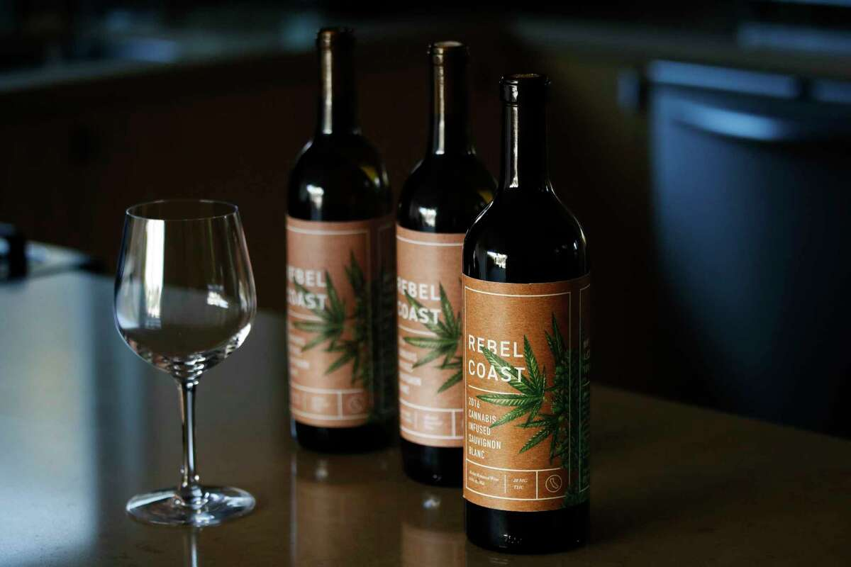 In this Dec. 22, 2017, photo, three bottles of Rebel Coast Winery's cannabis-infused wine sits in Los Angeles. As the world's largest legal recreational marijuana market takes off in California, the trendsetting state is set to ignite the cannabis-culinary scene. Rebel Coast Winery?'s THC-infused sauvignon blanc is made from Sonoma County grapes, but the alcohol is removed in compliance with regulations that prohibit mixing pot with alcohol. (AP Photo/Jae C. Hong)