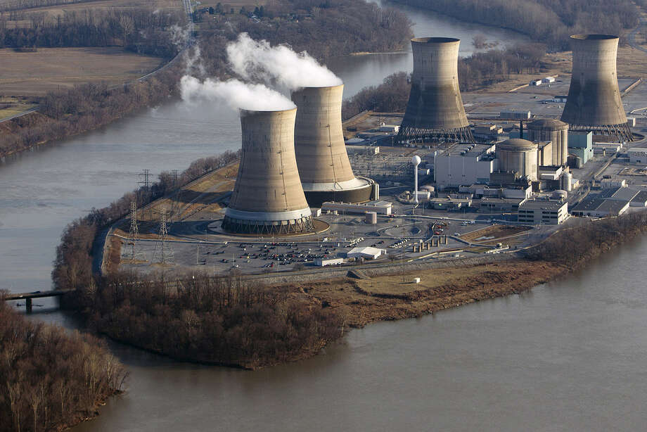 Cooling towers emit steam at Pennsylvania's Three Mile Island nuclear plant. Natural gas has a cost advantage over nuclear. Photo: Andrew Harrer / Bloomberg News