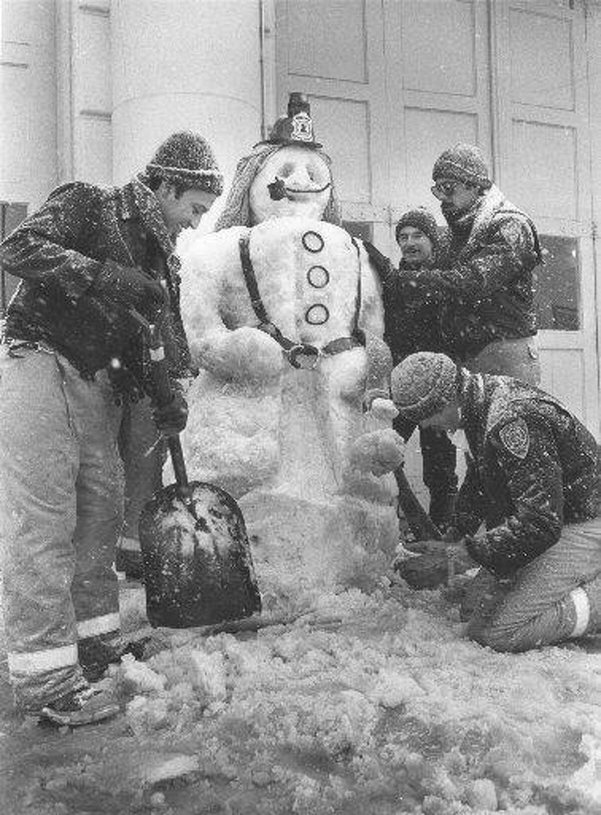 Firefighters from Fire Station No. 1's day shift make a snowman on Jan. 12, 1985.