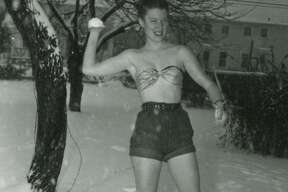 Temple resident, Joan Dix, wearing shorts, a small top and cowboy boots, throws snowballs in January 1949 when almost 5 inches of snow fell.