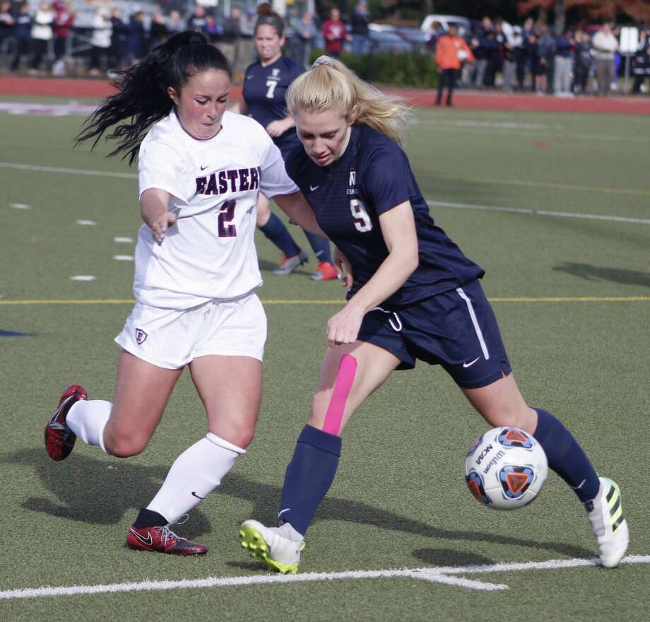 Western Connecticut's Autumn Sorice, right, moves the ball upfield as Eastern Connecticut'sAlexa Moustakakis defends during the Little East Conference women's soccer championship match in Mansfield Nov. 4, 2017. Photo: Richard Gregory / Richard Gregory
