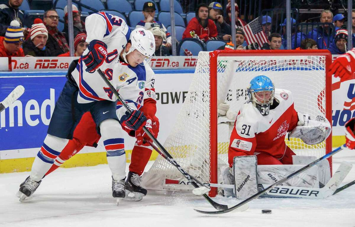 USA's Kieffer Bellows goes to the net against Denmark's Kasper Krog, right, during the first period of IIHF World Junior Championship preliminary round hockey action in Buffalo, N.Y., Tuesday, Dec. 26, 2017. (Mark Blinch/The Canadian Press via AP)