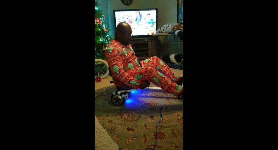 A video of a San Antonio dad's attempt at using a hover board on Christmas 2017 has garnered millions of views on Facebook. Photo: Screengrab, Courtesy Kristie Silva Scipio/Facebook