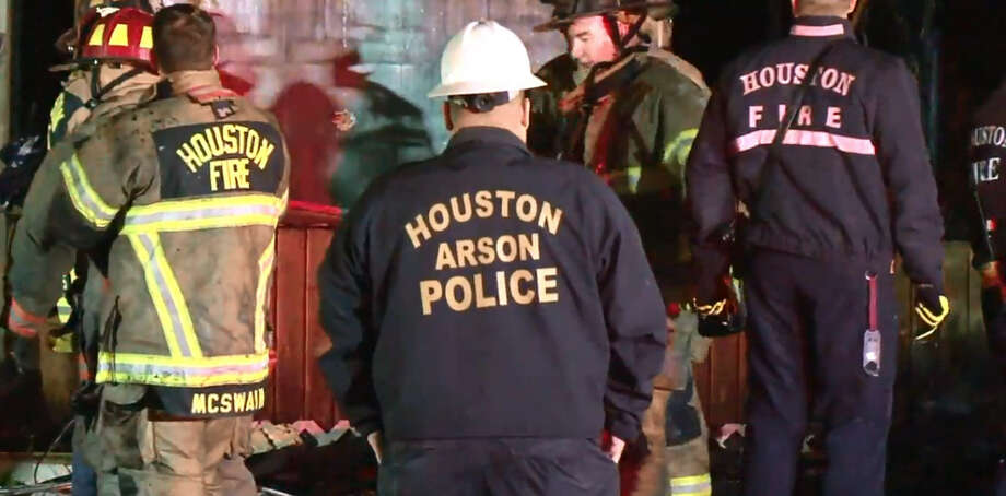 Houston Fire Department responded to a house fire late Tuesday evening. Authorities reported no injuries. Investigators say two men were arrested in connection to the fire. HFD has ruled the fire arson. Photo: Metro Video