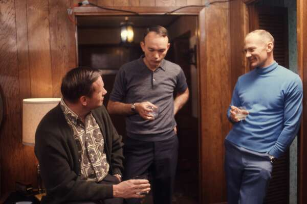 American astronauts, from left, Neil Armstrong, Michael Collins, and Buzz Aldrin, the crew of NASA's Apollo 11 mission to the moon, as they talk over drinks in a wood-panelled room, Houston, Texas, March 1969. (Photo by Ralph Morse/The LIFE Picture Collection/Getty Images)
